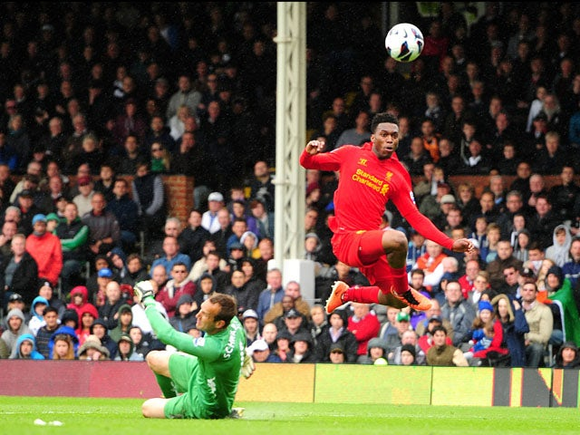 Liverpool's Daniel Sturridge scores his third goal against Fulham on May 12, 2013