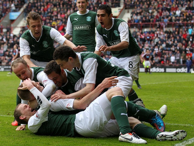 Hibernian's Ross Caldwell celebrates scoring in the SPL clash with Hearts on May 12, 2013