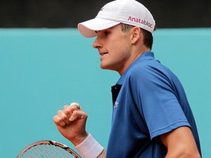 Result: Isner edges past Blake
