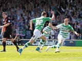 Yeovil's Kevin Dawson celebrates with team mates after scoring the opening goal against Sheffield United on May 6, 2013