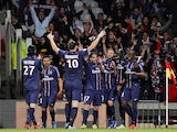 PSG players celebrate their side's goal in the Ligue 1 match against Lyon on May 12, 2013