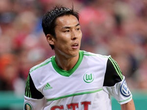 Wolfsburg's Makoto Hasebe during the German Soccer Cup semi final wiht FC Bayern Munich on April 16, 2013