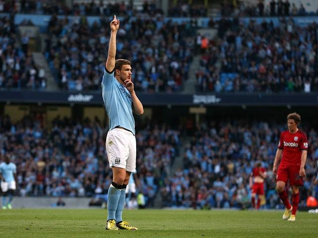 Manchester City's Edin Dzeko celebrates scoring against West Bromwich Albion on May 7, 2013