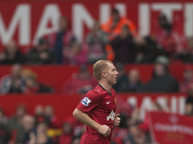 Manchester United's Paul Scholes is substituted during his last ever match at Old Trafford on May 12, 2013