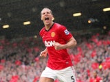 Manchester United defender Rio Ferdinand celebrates scoring against Swansea on May 12, 2013
