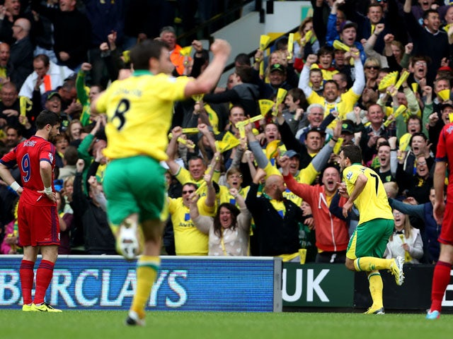 Norwich City's Robert Snodgrass celebrates after scoring against West Brom on May 12, 2013