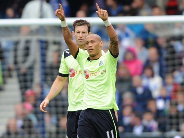 Newcastle United's Yoan Gouffran celebrates scoring his side's second goal against QPR on May 12, 2013