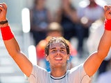 Rafael Nadal celebrates after beating Pablo Andujar in the Madrid Open semi finals on May 11, 2013