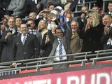 Wigan Athletic manager Roberto Martinez lifts the FA Cup trophy after his side's victory over Manchester City on May 11, 2013
