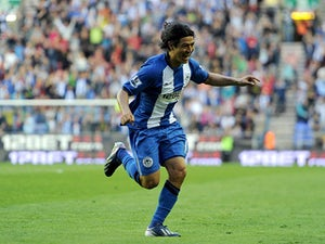 Half-Time Report: Espinoza puts Wigan in front