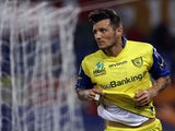 Chievo's Cyril Thereau celebrates scoring against AS Roma on May 7, 2013