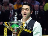 Ronnie O'Sullivan celebrates with the trophy after beating Barry Hawkins in the World Championship final on May 6, 2013