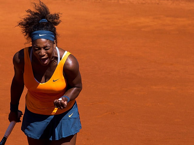 Serena Williams celebrates after beating Sara Errani in the Madrid Open semi finals on May 11, 2013