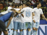 Lazio players congratulate Sergio Floccari following a goal against Inter on May 8, 2013