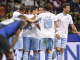Lazio players congratulate Sergio Floccari following a goal against Inter on May 8, 2013