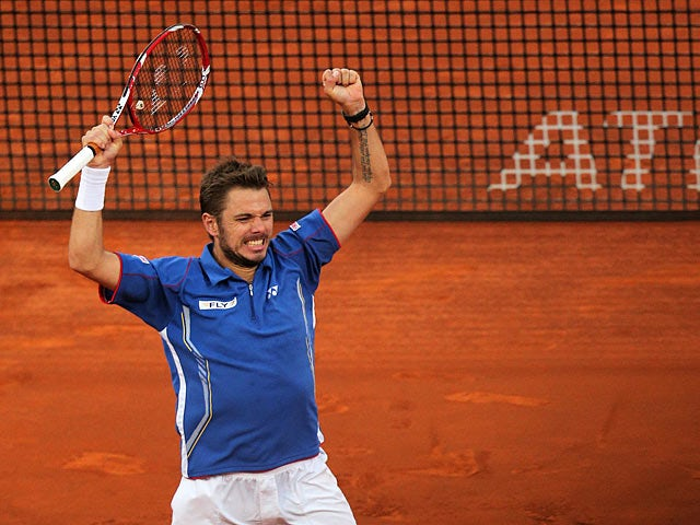Stanislas Wawrinka celebrates after beating Tomas Berdych in the Madrid Open semi finals on May 11, 2013