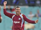 West Indies' Sunil Narine raises arms in jubilation after taking the wicket of Australia's Aaron Finch on February 8, 2013