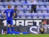 Wigan players look dejected following Swansea City's third goal on May 7, 2013