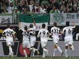 Wolfsburg players celebrate scoring against Borussia Dortmund in the Bundesliga match on May 11, 2103