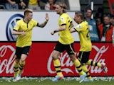 Dortmund's Marco Reus celebrates scoring his side's third goal against Wolfsburg on May 11, 2013