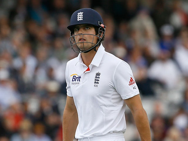 Alastair Cook leaves the field after being caught out by BJ Watling on May 16, 2013