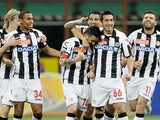 Udinese's Antonio Di Natale is congratulated by team mates after scoring his team's third against Inter on May 19, 2013