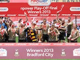 Bradford City players celebrates with the trophy after beating Northampton in the League Two play off final on May 18, 2013