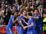 Chelsea's Branislav Ivanovic is mobbed by team mates after scoring the late winner against Benfica on May 15, 2013
