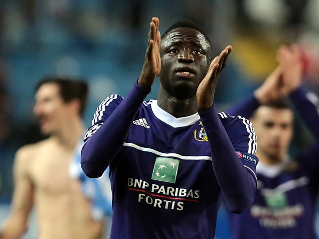 Anderlecht's Cheikhou Kouyate applauds fans at the final whistle on December 4, 2012