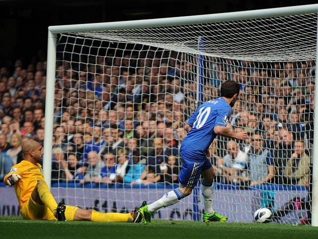 Chelsea's Juan Mata scores the first goal of the Premier League encounter with Everton on May 19, 2013