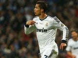 Real Madrid's Cristiano Ronaldo celebrates after scoring the opening goal during the Copa del Rey Final against Atletico Madrid on May 17, 2013