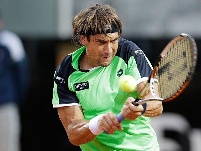 David Ferrer returns the ball to Fernando Verdasco during the Rome Masters on May 15, 2013