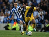 Brighton's David Lopez and Crystal Palace's Wilfried Zaha battle for the ball on May 13, 2013