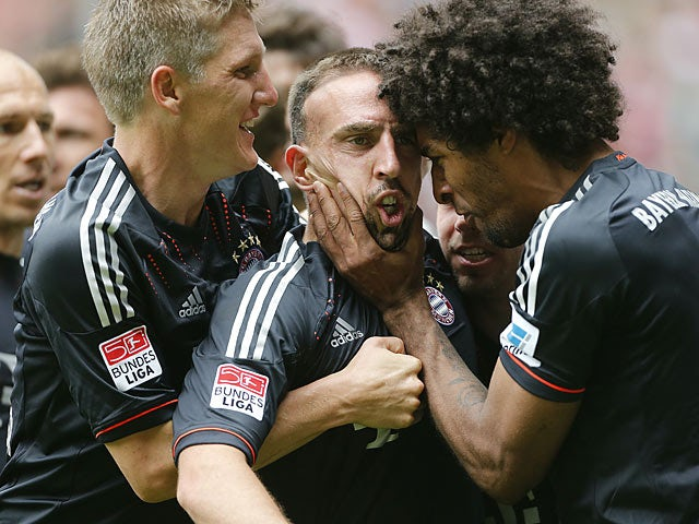 Bayern's Franck Ribery is mobbed by team mates after scoring his second goal against Borussia Monchengladbach on May 18, 2013