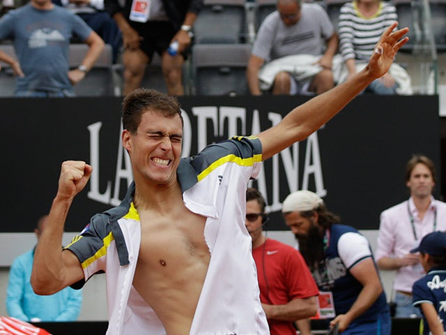Jerzy Janowicz celebrates after beating Jo-Wilfried Tsonga during the Rome Masters on May 15, 2013