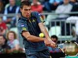 Jerzy Janowicz returns the ball to Richard Gasquet during their match at the Rome Masters on May 16, 2013