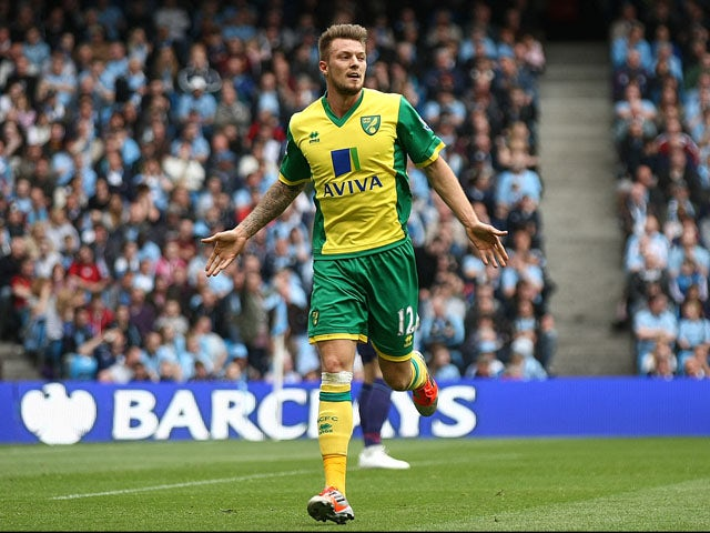Norwich City's Anthony Pilkinton celebrates scoring against Manchester City on May 19, 2013