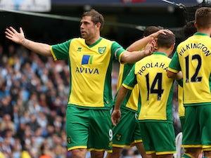 Wigan complete Holt signing