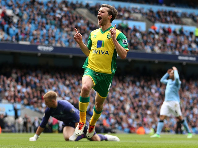Norwich City's Jonathan Howson celebrates scoring his sides third goal against Manchester City on May 19, 2013