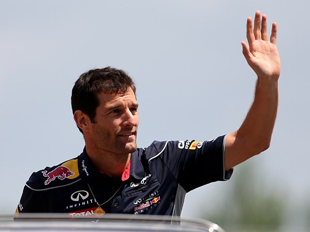 Red Bull driver Mark Webber waves to the crowd on May 12, 2013