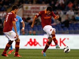 Roma's Marquinho scores the opening goal against Napoli on May 19, 2013