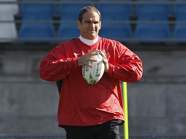 England rugby team manager Martin Johnston watches his team during a training session on September 24, 2011