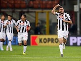 Udinese's Maurizio Domizzi celebrates after scoring his team's second goal against Inter on May 19, 2013