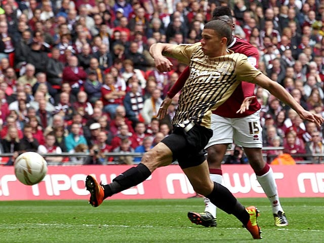 Bradford's Nahki Wells scores his team's third goal against Northampton on May 18, 2013