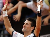 Novak Djokovic celebrates after defeating Alexandr Dolgopolov in the Rome Masters on May 16, 2013