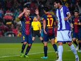 Barcelona's Pedro celebrates with team mate Xavi after scoring the opening goal against Real Valladolid on May 19, 2013
