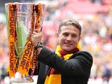 Bradford boss Phil Parkinson celebrates with the trophy after his team beat Northampton in the League Two play off final on May 18, 2013