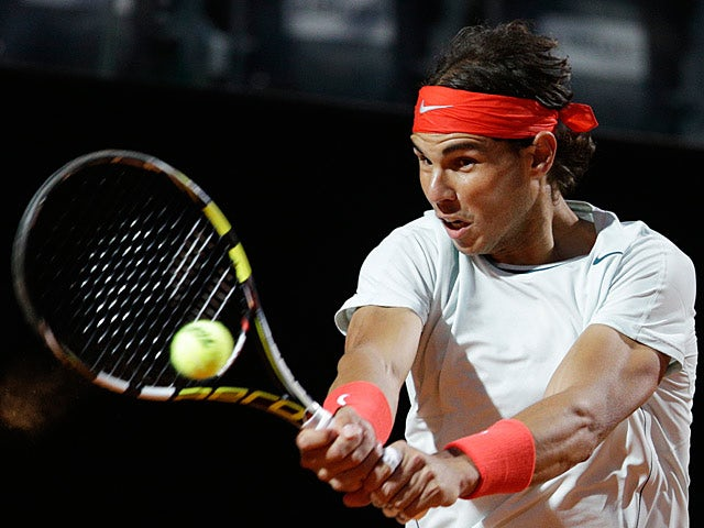Rafael Nadal returns the ball to Fabio Fognini during the Rome Masters on May 15, 2013