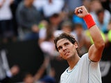 Rafael Nadal celebrates after defeating Ernests Gulbis at the Rome Masters on May 16, 2013