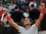 Rafael Nadal celebrates after defeating Tomas Berdych at the Rome Masters on May 18, 2013